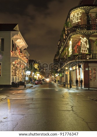 Christmas Lights on the corner of Royal and Dumaine Streets in the French Quarter of New Orleans, Louisiana - stock photo