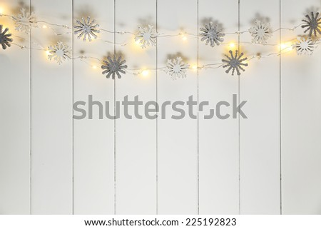 christmas lights on wood background - stock photo