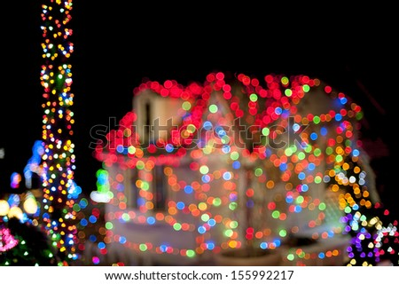 Christmas lights with house on the background - stock photo