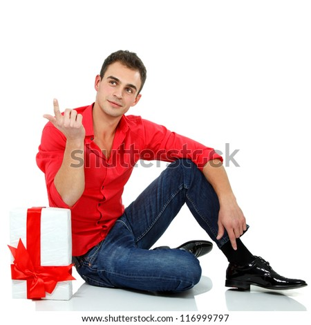 Christmas man with gift box, full length portrait of attractive holiday guy with present over white background - stock photo
