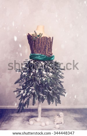 Christmas Mannequin Dressed In Fir Branches with a polar bear and snowballs - stock photo
