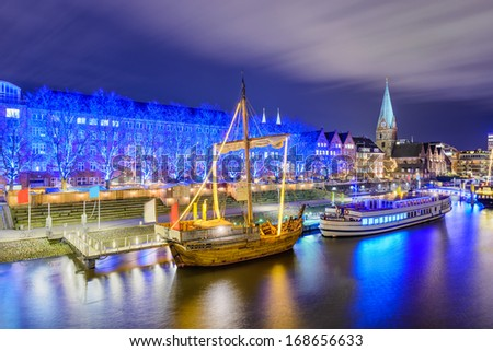 Christmas market illumination at the riverside in Bremen, Germany - stock photo