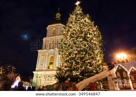 Christmas market on Sophia Square in Kyiv, Ukraine. Main Kyiv's New Year tree and Saint Sophia Cathedral on the background - stock photo