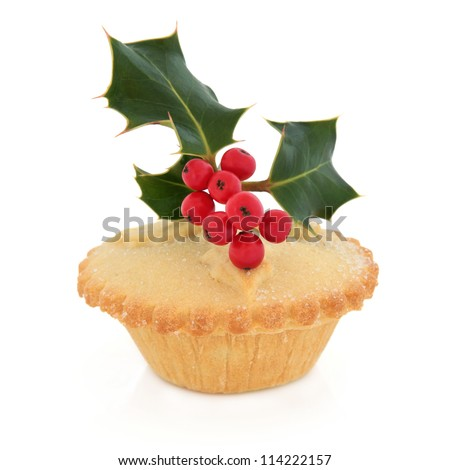 Christmas mince pie with holly and red berry leaf sprig over white ...