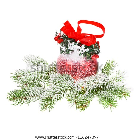 Christmas motives - branch of a Christmas tree with big red decorated ball isolated on white background - stock photo