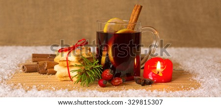 Christmas mulled wine.Glass with mulled wine on a snow  background. - stock photo