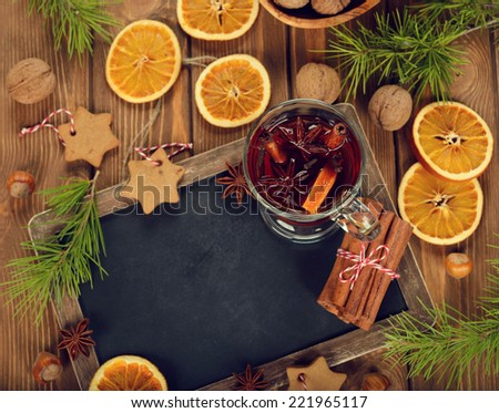 Christmas mulled wine on brown background - stock photo