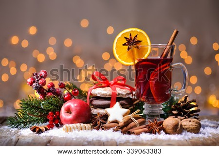 Christmas mulled wine with oranges and spices - stock photo