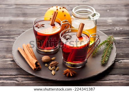 Christmas mulled wine with spices and honey - stock photo
