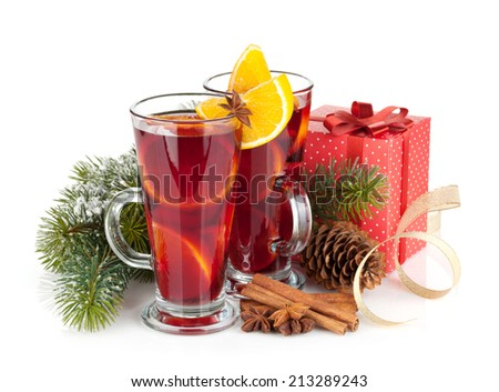 Christmas mulled wine with spices, gift box and snowy fir tree. Isolated on white background - stock photo