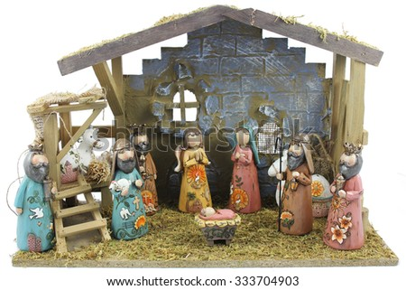 Christmas nativity scene of the birth of Jesus depicted with figurines - stock photo