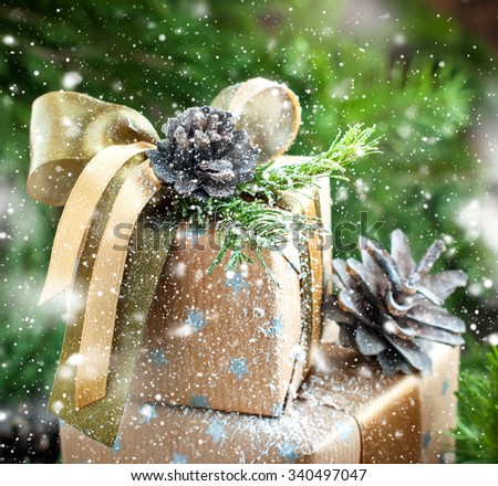Christmas Natural Decor on Vintage Boxes, pine cones, ribbons and fir tree. Drawn Snow. - stock photo