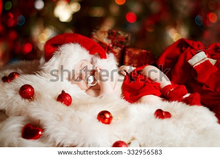 Christmas Newborn Baby, New Born Kid Sleeping in Red Santa Hat, one month old - stock photo