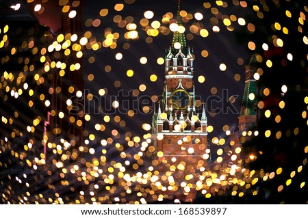 Christmas night Moscow atmosphere with Kremlin Spassky Tower in center holiday background   - stock photo