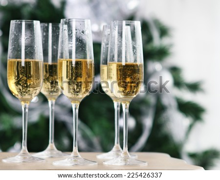 Christmas or New Year Celebration.Champagne near the Christmas tree - stock photo
