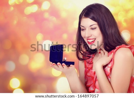 Christmas or New Year Gift. Surprised Woman - stock photo
