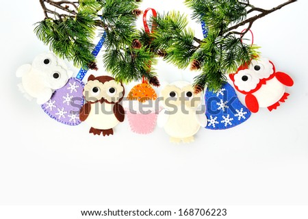 Christmas ornament hanging accessories handmade from felt on a white background - stock photo