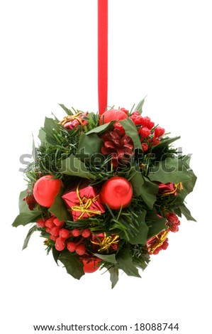 Christmas ornament, red and gold elements on green artificial foliage ball, isolated on white background (isolation done in-camera) - stock photo