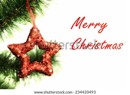 Christmas ornament red star on tree branch - stock photo