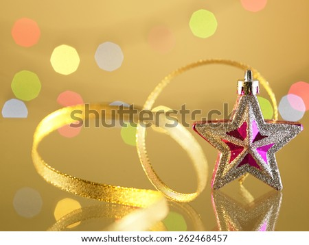 christmas ornament star with ribbon - stock photo