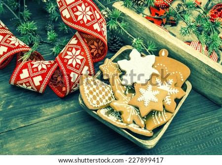 christmas ornaments and gingerbread cookies. vintage still life. retro style toned picture - stock photo