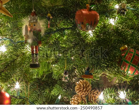Christmas ornaments are decorations (usually made of glass, metal, wood or ceramics) that are used to festoon a Christmas tree. - stock photo