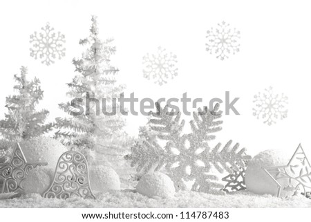 Christmas ornaments on snowflakes. - stock photo