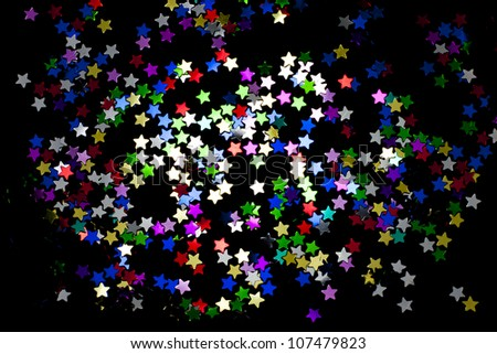 Christmas party background with stars in the dark - stock photo
