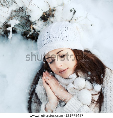 christmas picture of dreaming girl with snowflakes in the forest - stock photo