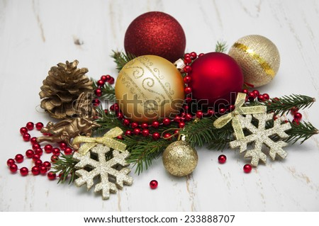 Christmas Pine and Bauble on old wooden background - stock photo