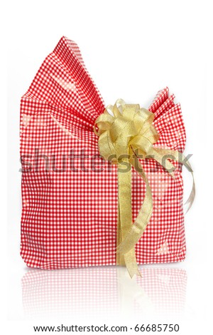 Christmas pink rose gift box tied with gold ribbon bow on white background - stock photo