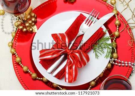 Christmas plate and silverware with red wine - stock photo