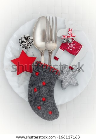 Christmas plate with spoon, fork and Christmas decoration - stock photo