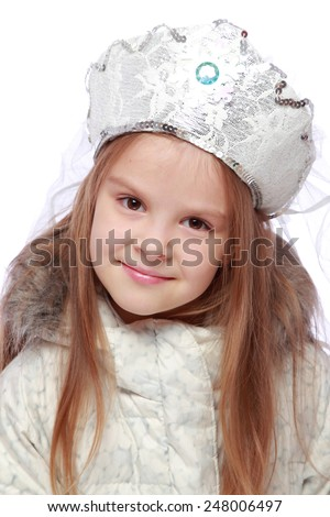 Christmas portrait of a beautiful little girl in a winter coat and a Russian headdress on a white background - stock photo