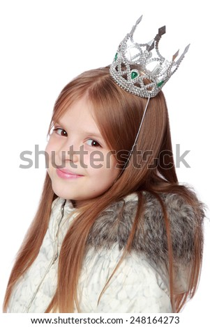 Christmas portrait of a beautiful smiling young girl wearing a crown isolated on a white - stock photo
