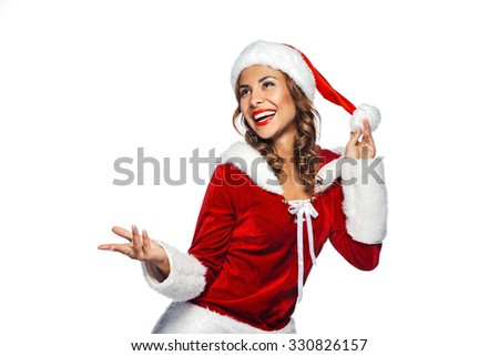 Christmas portrait of beautiful mixed-race santa girl. Young sexy brunette woman wearing santa claus clothes. Snow Maiden cheerfully smiling on white background - stock photo