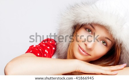 Christmas portrait of one beautiful young woman - stock photo