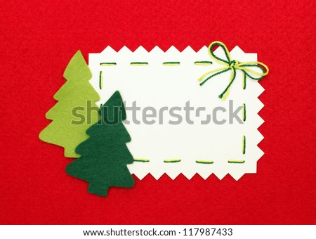 Christmas postcard: empty  blank and  new year trees on red background - stock photo