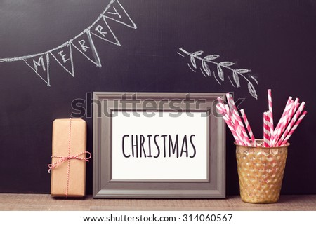 Christmas poster mock up template over chalkboard background - stock photo