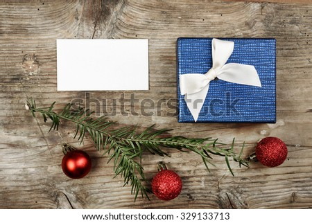 Christmas present and empty card on wooden table. - stock photo