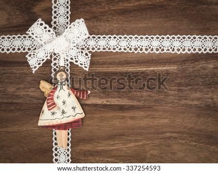 Christmas, present, angel on wood - stock photo