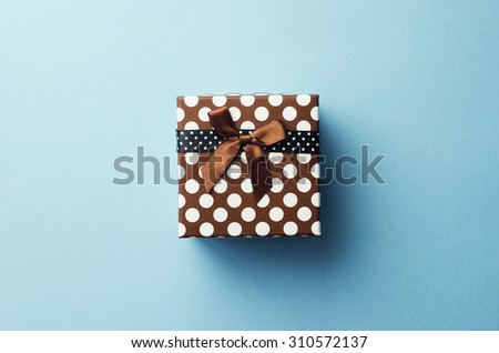 Christmas present box over blue background, above view. - stock photo