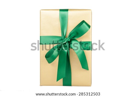 christmas present golden on edge - stock photo