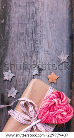 Christmas present on aged wooden background. Selective focus. - stock photo