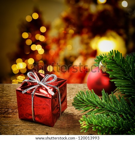 Christmas present on festive lighted background - stock photo