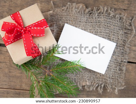 christmas present on wooden background - stock photo