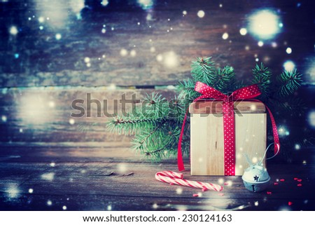 Christmas present with candy canes on dark wooden background in vintage style  - stock photo