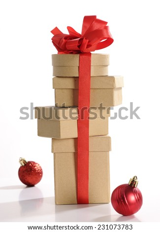 christmas present with red ribbon - stock photo