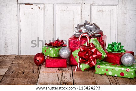 Christmas Presents and Ornaments on Wooden Background - stock photo