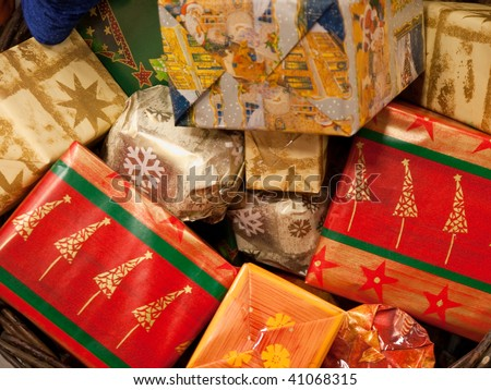 Christmas Presents Gifts stacked under a tree - stock photo